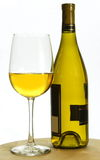 White chardonnay wine bottle and glass Royalty Free Stock Images
