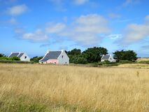 White charming house in field at French Stock Photos