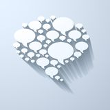White chat bubble symbol on light grey background Stock Images