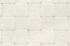 White checked carpet. A woolen white carpet with a relief checked pattern royalty free stock images