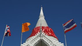White chedi draped in red fabric stock video