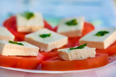 White cheese. Bulgarian white cheese with parsley on tomato slices Royalty Free Stock Photos
