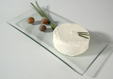 White Cheese. White wheel of cheese, with fruit and herb, glass platter royalty free stock photography