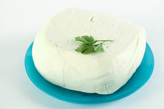 White cheese on a blue azzure plate. Food stock image