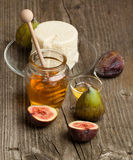 White cheese with figs and honey Royalty Free Stock Images