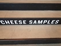 White cheese samples sign on black and grey cement stairs stock photo