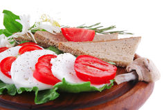 White cheese slices and vegetables Stock Photography