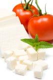 White cheese and tomato. White cow's cheese and tomato on white background Stock Photos