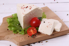 White cheese with tomatoes and fresh salad Royalty Free Stock Photo