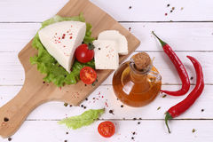 White cheese with tomatoes and hot pepper Royalty Free Stock Photography