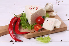 White cheese with tomatoes and hot pepper Royalty Free Stock Photos
