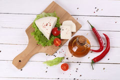 White cheese with tomatoes and hot pepper Stock Photos