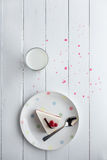 White cheesecake with red berries on a wooden table. Still life Royalty Free Stock Images