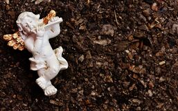 White Cherub Playing Flute Ceramic Figurine Royalty Free Stock Image