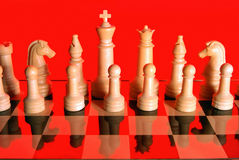 White chess chips on red background Stock Images