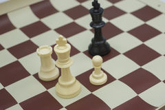 White chess figure challenging black king Royalty Free Stock Photos