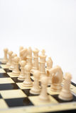 White chess figures with king in the focus Royalty Free Stock Photos