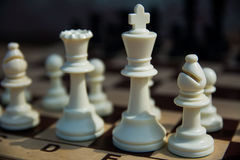 White chess figures. Photo White chess king and queen standing on a chessboard Royalty Free Stock Photos