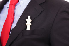 White chess king in black suit pocket Stock Photos