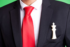 White chess king in pocket of a businessman Stock Images