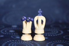 White chess king and queen. Close up of wooden white king and queen chess pieces Stock Photos