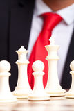 White chess king, queen and pawns Royalty Free Stock Image