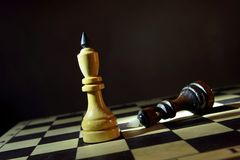 White chess king won black one. Victory and defeat Royalty Free Stock Photos