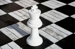 White Chess king on wooden board. White Chess king on wooden plank board Stock Image