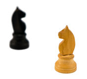 White chess knight figure blurr black horse white Royalty Free Stock Photos