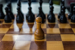 White chess pawn alone on a chessboard Stock Photos