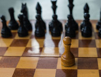 White chess pawn alone on a chessboard Royalty Free Stock Photos