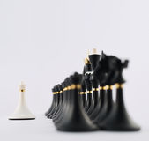 White chess pawn opposite to black ones Royalty Free Stock Photo