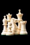 White chess pieces on black Stock Image