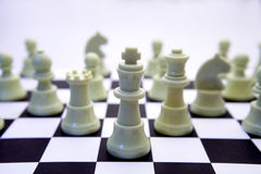 White chess pieces on board Royalty Free Stock Photography