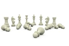White chess pieces fallen and standing Stock Photography