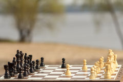 White chess pieces staying against black chess pieces Chess boar Stock Photos