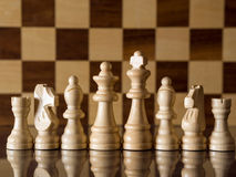 White chess team. In front of chessboard royalty free stock images
