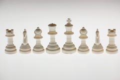 White chessmen. Close-up photography Stock Photos