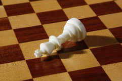 White chessmen on a chessboard. Close-up photography Royalty Free Stock Photos