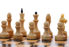 White chessmen on wooden chessboard Royalty Free Stock Image