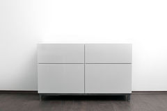 White chest of drawers in bright minimalism interior Stock Photos