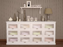 White chest of drawers filled with various things Stock Images