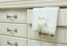 White chest of drawers with a towel Stock Photography