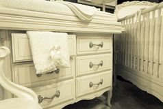 White chest of drawers with a towel Royalty Free Stock Photos