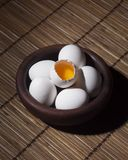 White Chicken Eggs on Brown Ceramic Bowl on Brown Woven Table Royalty Free Stock Photos
