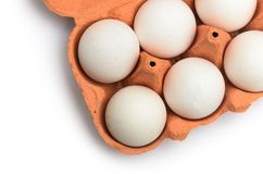 White chicken eggs in a cardboard container for storage and tran. Sportation isolated on white background Stock Photo
