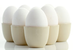 White chicken eggs in eggcups 2. White chicken eggs in eggcups on a white background Stock Photo