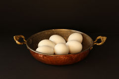 White chicken eggs in the pan Royalty Free Stock Image