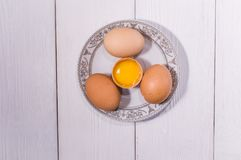 White chicken eggs. In straw on black boards Royalty Free Stock Photography