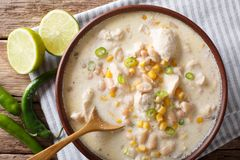 White chili chicken with cannellini beans and corn close-up in a Stock Image